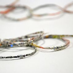 Liberty stacking bracelets by papermode, via Flickr