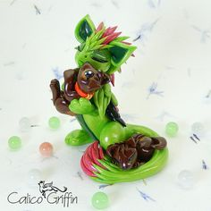 Roselyn - griffin and puppies - clay sculpture - Premo Sculpey polymer figurine sculpture dragon gryphon green pink rose dog puppy puppies