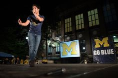 """Former Michigan student and current """"Glee"""" cast member Darren Criss addresses the crowd during a pep rally Friday, Sept. 6, at the Diag the night before the Michigan Wolverines take on Notre Dame at Michigan Stadium. Courtney Sacco I AnnArbor.com"""