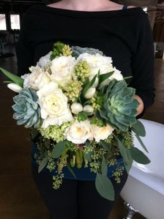 organic bouquet with succulents and other textural elements