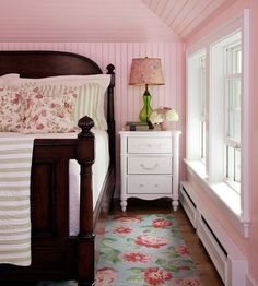 I like the paneling...it gives the room cozy charm. Walls done in beaded board bring texture, visual height, and country cottage flair to the petite bedroom. Tall lamps bedside also help draw the eye upward.