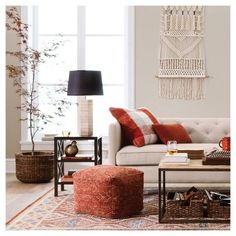 Transitioning your home's decor from summer to fall is as easy as pumpkin pie with the Fall Living Room Furniture and Decor Collection from Threshold. From wool throw pillows to macrame wall tapestries to wicker baskets to lamps that give off a warm glow, hunkering down on chilly fall nights will be as cozy as it is pretty. All that's left to do is switch on your table lamp, curl up on the couch with a warm throw and good book, and you'll be ready for the cooler seasons in no time.
