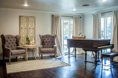 Elegant remodeled dining room with an antique baby grand piano on HGTV's Fixer Upper.