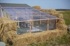 Underground greenhouse using straw bales and plastic sheeting.