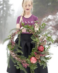 Gorgeous Kim of @sheisclothing styling one of our fresh seasonal wreaths up on Grouse Mountain!
