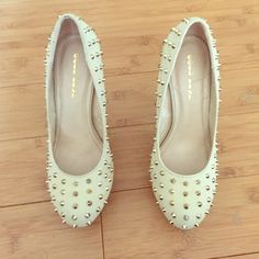 Gold stilettos with spikes Worn no more than two times. Gold stilettos with gold spikes. Size 9 Gold Fish Shoes