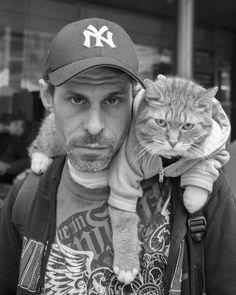 Just a man and his feline companion (Toronto, Ontario)