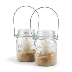 From Coastal Living Magazine: Beachify simple Mason jars with natural materials such as sand or stone, which hold votives in place. Another idea: Add citronella candles to keep bugs at bay. This could also work with an outdoor/beach wedding lining pathways.    Buy it: Hanging Mason Jars, $7.50 each; potterybarn.com.