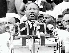 Martin Luther King delivering the I Have A Dream speech. His message of non-violent resistance in the cause of social justice is still something to aspire to in a world where raw power holds sway. He was also flawed, not perfect. My DJing business MLK Sounds is named in his honour http://www.facebook.com/MLKSounds and http://twitter.com/mlksoundsdj