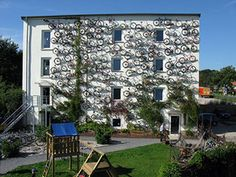 """A wall of bicycles on a store in Germany. My only problem is that probably most could still be ridable. I love the organization """"Bikes for the World.""""  A usable bike can make all the difference to a person with no other means of transportation. Still--I think this is """"Cleverness."""""""