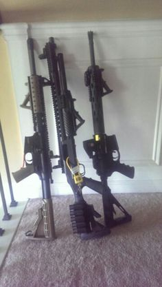 Smith & Wesson M&P 15-22, Mossberg 500, and Colt CSR