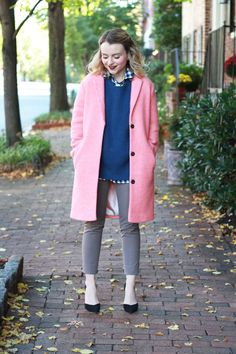 Pair a cozy knit Gap sweater over a gingham button down for a fall stroll. Layer a statement coat over the look for a pop of color. We love this outfit styled by blogger Poor Little It Girl.