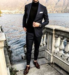 Modern menswear with a suit, turtleneck and pocket square.