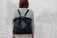 Black leather handbag made from high quality Italian leather. This leather handbag have two wearing variations for maximal comfort. You can wear it as a backpack and keep two hands free or you can wear it as a handbag by holding/hanging the round handles on your hand.  ------------------------------------------------------------- << Product Feature >> - Height - 35 cm / 13.7 - Width - 36 cm / 14.17 - Max shoulder straps lenght - 70 cm / 27.5 - Adjustable shoulder straps - Holding handles…