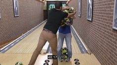 13 bowling balls held at once - guiness world record