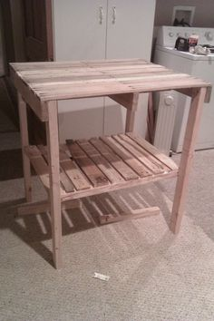 Kitchen Island built out of shipping Pallets!