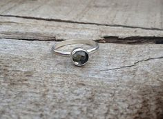 A stunningly elegant faceted or rose cut 6mm pyrite stone has been set in sterling silver with a handmade sterling silver ring band from half dome wire. The pyrite is a doublet cabochon so it has mor