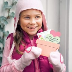 Flower seed Valentines.  Packet of flower seeds with a flower pot cut out.  Card says:  Let's watch our friendship grow.
