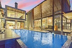 The extraordinary, contemporary estate composed of glass and steel includes a magnificent infinity-edge pool that is perfect for entertaining on those particularly hot summer days.