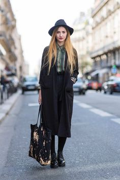 Paris street style: black and white and Spring all over. Elisa Baudouin in a long black coat, hat, and bleached tote bag.