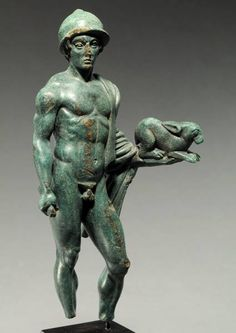 Why they hate us #3: ETRUSCAN BRONZE NUDE WARRIOR HOLDING A SACRIFICIAL HARE. 4th Century BCE. H. 5 7/8 in. (15 cm.) He wears a Negau helmet, a cloak over his left shoulder that wraps around his left forearm. On his extended left hand crouches a hare; a dagger in his right hand. Fine olive green patina. Superb style. It has been suggested that this is a representation of Turms (Hermes).