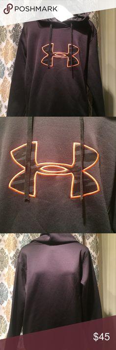 Under Armour hooded sweatshirt Under Armour hooded black & orange sweatshirt. In good shape. Kangaroo pouch Under Armour Tops Sweatshirts & Hoodies
