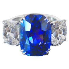 Jewel Of Kashmir 10.88 carat Sapphire Two Cushion Cut Diamonds 4.03 carats Total | From a unique collection of vintage three-stone rings at https://www.1stdibs.com/jewelry/rings/three-stone-rings/