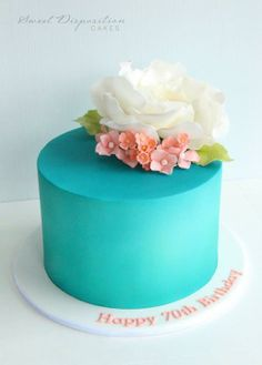 Teal blue cake with sugar flowers b Sweet Disposition Cakes