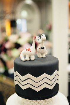 Adorable dinosaur wedding toppers based on a favorite children's book.    Stylish + Lighthearted // Black + White Real Wedding at Hotel Shattuck Plaza | onelove photography