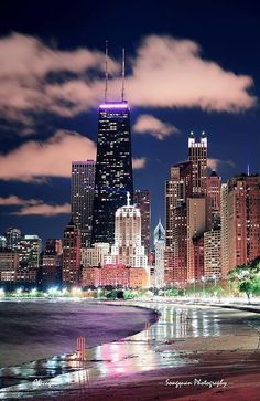 Picture of Chicago city urban skyscraper at night at downtown lakefront illuminated with Lake Michigan and water reflection viewed from North Avenue Beach. stock photo, images and stock photography. Chicago Travel, Chicago City, Chicago Skyline, Chicago Illinois, Chicago Lake, Chicago Nightlife, Chicago Today, Milwaukee City, Chicago Usa
