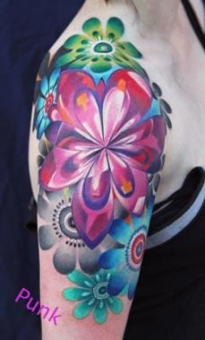 Flower blooming on the round of the shoulder    I don't go into tatoos but this really pretty.