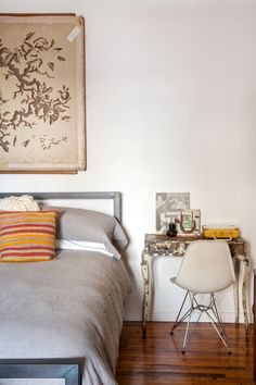 """Sneak Peek: An Eclectic Philadelphia Loft. """"The bed from Room and Board. The picture is of my parents when they were in a play together (before they dated). The shadow box is an amazing purse that my Nana made my mother. My grandfather made the box and my Nana filled it with keepsakes that represented my mom."""" #sneakpeek"""