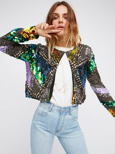 Bird Of Paradise Jacket | Stunning cropped jacket with stunning embellishments allover. Multi-colored sequins, edgy studs and beautiful beading make this an ultra cool statement piece. Small front hook closure. Lined.