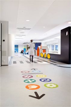Emma's children's hospital by Opera Amsterdam Use the symbols to help direct people thru the hospital. Floor Signage, Directional Signage, Wayfinding Signs, Clinic Design, Healthcare Design, Wc Symbol, Design Clinique, Hospital Signage, Floor Graphics