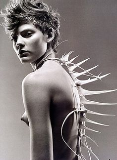 Nude with bone adornments; lion fish
