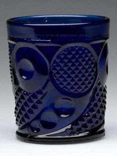 "HORN OF PLENTY WHISKEY TUMBLER, cobalt blue, polished pontil mark. Boston & Sandwich Glass Co. and others. Third quarter 19th century. 3"" H, 2 5/8"" D rim, 2 1/4"" D base. <BR><I>Undamaged.</I><BR> Provenance: Personal collection of Judith (Judy) Cronin, Orleans, MA.<BR>Catalogue Note: Previously unrecorded and quite possibly unique. Any colored examples of Horn of Plenty are considered very to extremely rare; no other forms in this pattern are known in cobalt blue.<BR>"