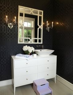 love the subtle patterning in the wall paper, and on the mirror