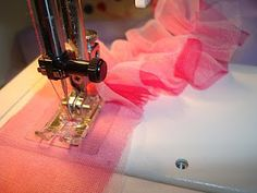 Adjust your sewing machine tension to a tighter level (I put mine on 7) and increase your stitch length to the longest setting. Now sew. The chiffon with automatically begin to gather and ruffle before your eyes.