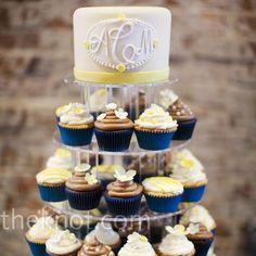 Love the navy wrappers and doing cupcakes with a cake on the top. Just incorporate  red instead of yellow :)
