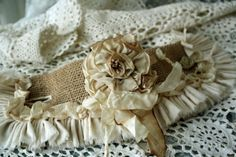 Burlap cuff lined with soft felt with  French rose pin