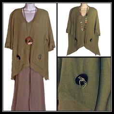 Asymmetrical V-Neck Lagenlook Tunic European Chic Wonderful green tunic top with button details. Slits in front and on the sides; 3/4 length sleeves. 65% polyester, 35% viscose. One size fits most. Tops