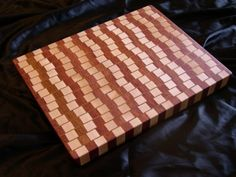 Made from bubinga maple and imbuia this cutting boards arrangement gives off an eye warping illusion of bent and angled lines. Diy Cutting Board, Wood Cutting Boards, Butcher Block Cutting Board, Chopping Boards, Wooden Serving Trays, Serving Board, Le Chef, Custom Woodworking, Woodworking Skills