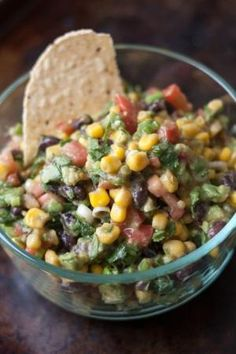 Ingredients  1- 15 oz can corn 1 can black beans 2 avocados (cubed) 2/3 cup chopped cilantro 8 green onion stalks, sliced 6 roma tomatoes Dressing:  1/4 cup olive oil 1/4 cup red wine vinegar 2 cloves minced garlic 3/4 teaspoon salt 1/8 teaspoon pepper 1 teaspoon cumin Mix first 6 ingredients together.  Combine dressing ingredients and pour over corn mixture.  Serve with tortilla chips. by alba