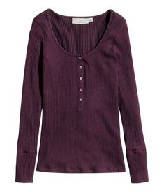 Long-sleeved Henley shirt in soft rib-knit jersey. Slightly lower-cut neckline at front and button placket at top.