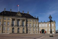 Amalienborg Palace is the winter home of the Danish royal family, and is located in Copenhagen, Denmark. It consists of four identical classifying palace façades with rococo interiors around an octagonal courtyard (Amalienborg Slotsplads); in the centre of the square is a monumental equestrian statue of Amalienborg's founder, King Frederick V.