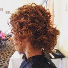 Naturally curly hair low bun updo