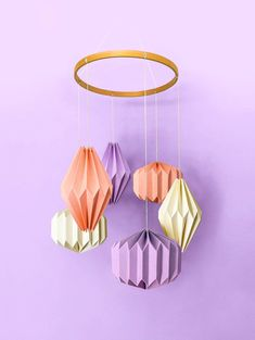 """A stunning hand crafted hanging mobile consisting of six individual geometric shapes folded from specialty stocks. A beautiful wooden """"halo"""" hovers above—complementing the materials below. A unique display worthy of any nursery or child's room. Child's Room, Nursery Room, Nursery Decor, Baby Nest, Hanging Mobile, Kidsroom, Geometric Shapes, Baby Shop, Babyshower"""