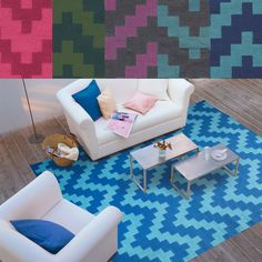 This chevron patterned rug brings dynamic color to any setting. With contrasting colors and its distinctive undulating pattern, the energy this brings to your home is undeniable.
