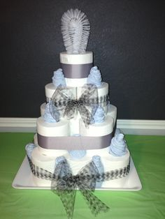 Housewarming toilet paper cake. Cake made with toilet paper, blue face towels, a scrubber, ribbon and tulle. Just pile the toilet paper, place the face towels in the holes, and scrubber on top. Cute and easy.