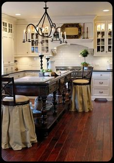 love the skirts on the barstools. Cool island with marble cutting boards
